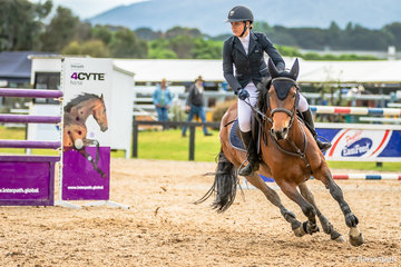 Madeline Cox and her mare Eclipsis focused and on the job after the Interpath 4CYTE fence looking for home.  The combination placed 11th in the 130cm Stal Tops  Young Rider Championship.
