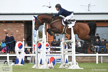 Back in Australia after a sojourn in Europe Phil Lever is pictured aboard Caroline Price's imported stallion, 'Calvino' that lowered just one fence in round one of the 2019 Keirnan Plant Hire Future Stars Final.