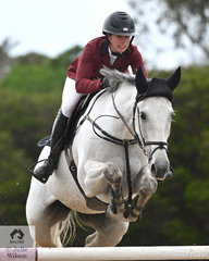 Popular rider from New Zealand and now resident in NSW, Bridget Berry is pictured aboard her, 'Turn It Blue NZPH' during round one of the Interpath Mini Prix Final.