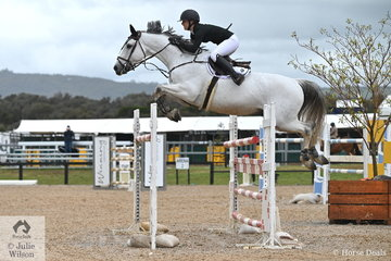 Successful NSW young rider, Jamie Priestley is pictured aboard her successful, 'Courage' during the first round of the Interpath Mini Prix Final.
