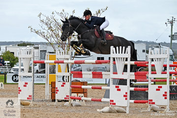 Izabella Stone is pictured aboard her, 'Lincoln MVNZ' during round one of the Interpath Mini Prix Final.