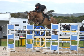 Chris Chugg posted the last of the five Interpath Mini Prix Final first round clears riding his imported, 'KG Queenie'. They set out meaning business in the jump off, but retired after lowering a fence to settle for firth place.