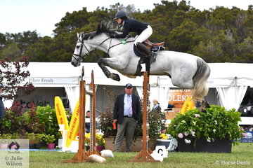 Gabi Kuna is pictured aboard the impressive stallion, 'Cera Cassiago' making his characteristic beautiful jump during the 2019 Pride's EasiFeed Australian Senior Showjumping Championships.