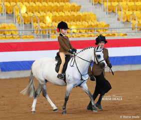"Robyn Woodland's exhibit ""Rivington Folk Singer"" was The TRAYNOR FAMILY Champion Leading Rein Show Hunter Pony, ridden by Rubi Mahaffey."
