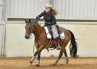 Cheryl Carter -Pintoy riding PJ Blazing Charary in the Senior Horse Ranch Riding