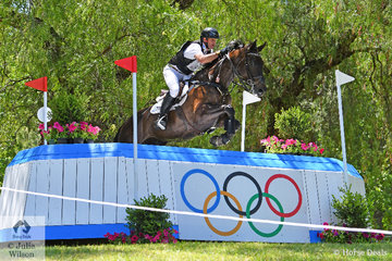 Stuart Tinney was delighted with his eight year old, imported 'Leporis' that posted a clear jumping effort around the Mitsubishi CCI5*-L cross country course. They added time penalties and hold fifth place heading in to the final phase tomorrow. They are pictured over the Gill Rolton Olympic fence.