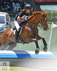 Hamish Cargill is pictured aboard his, 'Legolas KPH' bouncing out of the lake on the Mitsubishi CCI5*-L cross country course. They added time penalties and hold eighth place going in to the final phase tomorrow.