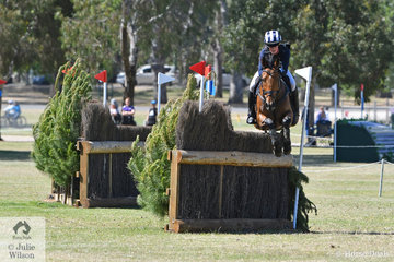 Sophia Landy from Victoria and her , 'Humble Glory' make sure of this narrow corner during their RM Williams CCI4*-S cross country run. They were right on the money and posted one of just two clear jumping and clear time rounds to hold sixth place.