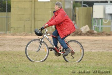 Di Schaeffer give her bike a workout during the dressage day of the Naracoorte Horse Trials.
