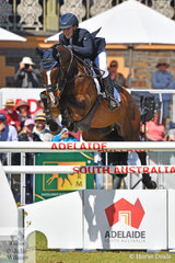 Madeline Wilson is pictured aboard her Fisherman's Friend gelding, 'I'm Bruce' on their way to seventh place in the Mitsubishi CCI5*-L.
