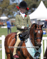"Champion  Child's Small Show Hunter Pony, 12.2hh & under. Rider under 17 years, ""Harrington Park Peek-A-Boo"" ridden by Maddy Gin"