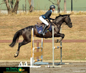 Competing on her 4 year old Filly Warmblood x Quarter Horse, Brooklyn Jalapeno in the Open 90cm was Molly Baker.
