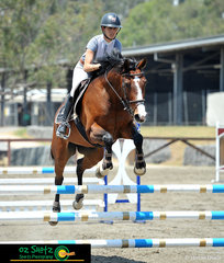 A beautiful pairing in the Class 6A 90cm Open at the 2019 Sydney Summer Classic was Katie Laurie riding her mare Queen Bee GNZ.