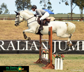 Showing a lovely position over the rustic fence during the Futurity Series Qualifier A2 was Coco Miles riding her horse Emcee Villain at the 2019 Sydney Summer Classic.