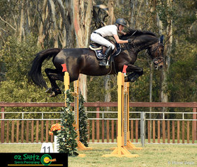 Being only 0.8 seconds away from taking second place off Tom McDermott in the Mini Prix Qualifier AM5 Jump Off was Olivia Hamood riding her horse Alan 111 Z.