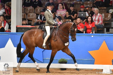 Representing Queensland, Paris Graham rode Samantha Watt's, 'Extatic GHP' by showjumper, Elias C to take third place in the Child's Small Show Hunter Hack Championship.