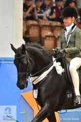 Tia Rose McKenzie from NSW rode her own , 'Mirinda Jackpot' to take third place in the Child's Small Show Hunter Galloway Championship.