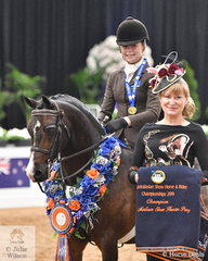 Riding for Victoria, Daizi Plumb rode  her, 'DP Chocolate' to claim the Child's Medium Show Hunter Pony Championship. Daizi is pictured with Samantha Applin, one of the three judges.