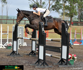 Off to a good start in the 1.20 m class was Erin Dickinson riding her horse Nicholas B at the Sydney Summer Classic held at Sydney International Equestrian Centre.
