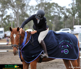 After a rough start to the competition and having to borrow gear from other riders after her equipment had been left behind, Michelle Spiteri and Araluen Gold finish on a high coming first in the 1.20m on Sunday.