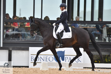 Mary Hanna rode Harmonie W to win the  FEI Prix St Georges, scoring 71.91%.