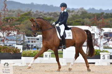 Sue West produced a nice test riding Balzac to take fifth place in the FEI Grand Prix CDN.