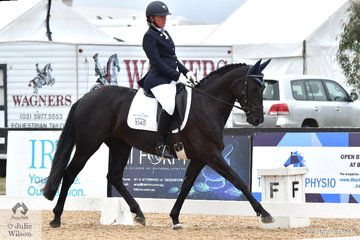 Nicole McOwn rode, 'Mellizo Park Furst  Dance' to take second place in Round 1 of the Seven Year Old Young Horse Championships.