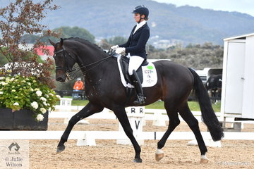 Maree Tomkinson is picture aboard her, 'Furst Deluxe' that won both Rounds 1 and 2 (with a score above 75%) of the Seven Year Old Young Horse Championship.