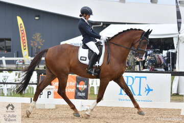 Melissa Robertson rode her, 'Rock Royaltee' to third place in Round 1 of the Seven Year Old Young Dressage Horse Championship.