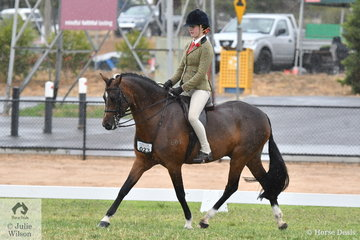 Taylor Shute rode her own and Rebecca Shute's well performed, 'Comeron Pop Rock' to win the class for Child's Show Hunter Pony 13-14hh.