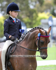 "Winners in the Rider 9 and under 12 years, Sabrina Gilmour riding ""Yurragar Supermodel"""