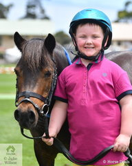 A delighted five year old Wyatt Ollie won the class for Brushed Paddock Pony/Horse.