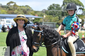 Emily Melville rode her, 'Son of a Gun' to win the award for Champion Local Ridden Exhibit. She is pictured with judge, Alison Kain.