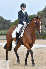 Olivia Bartlett rode Cooper Teddy to eighth place in the Elementary 3C horse class.