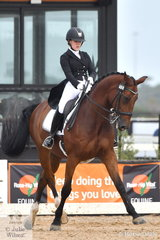 Lindsey Ware rode Aristede to win the Stable Ground FEI U25 Grand Prix, scoring 69.61%.