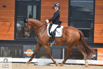 Tamara Campain riding Bon Chance took fourth place in the Charlie's Cookies Medium 4B.