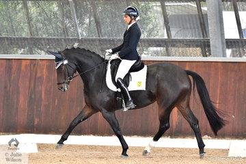 Deborah Oliver rode Highfields Bella Vita to win the Young Horse 7 Year Old Round 1 scoring 70.71.