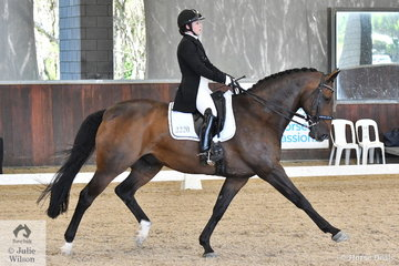 Sidney Hoffman rode Freedom C to eighth place in the FEI Intermediate I CDN.