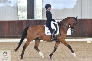 Amy Bachmann rode Silverdene Pharaoh to win the Freestyle Young riders CDIY.