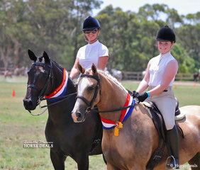 """Gayna Harvey riding her Champion Small Show Hunter exhibit """"Fidarzi"""", pictured with daughter Shilo Harvey riding her Champion Large Show Hunter Galloway exhibit """"HH Rose Gold""""."""