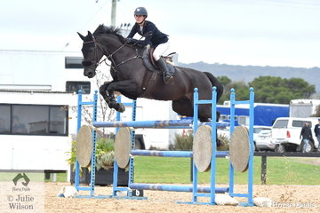Jessie Rice-Ward from NSW rode a clear round on Denison Park Style in the Open 130cm Art. 238.2.1.