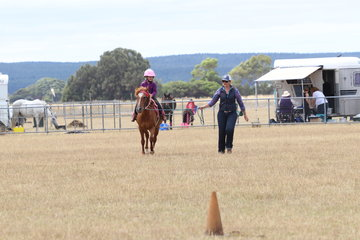 Ava riding her pony in the Wipper Snappers, with mum on the lead.