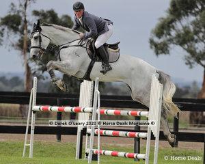 """Daniel Bourne riding """"Tulara Comania"""" in the 110cm class"""