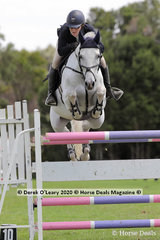 "Claire McDermott in the 140cm class riding ""Klydoscope"""