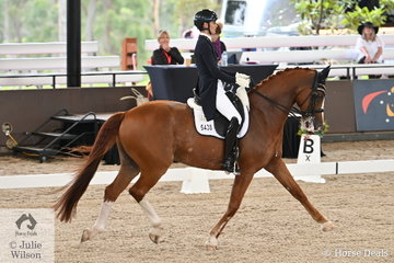 Sally Rizzuto is pictured aboard Vicki Newam's successful Diamond Hit gelding, 'Diamiond Star' during the Willinga Park Grand Prix CDI4*.