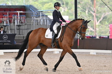 Jodie Newall is pictured aboard her Jive Magic gelding, 'Jive Matrix C' during the Intermediate 1 Freestyle.