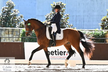 Sheridyn Ashwood rode her Ferrero Rocher gelding, 'Ashwoods Chocolate Box' to take fourth place in the Intermediate 1 Freestyle with 71.205%.