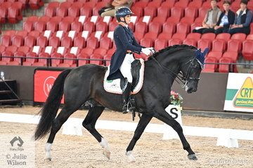 Riding for New Zealand, Holly Leach rode her 'HP Fresco' by Fackeltanz to second place in the Intermediate 1 Freestyle with 71.375%.