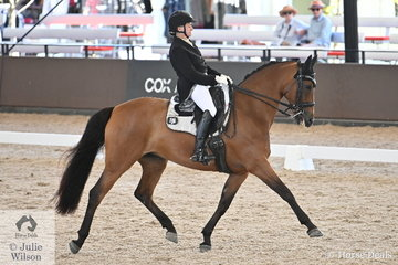 Sally Evans rode her home bred , 'A Spider Bite' by A'Seduction to fifth place in the Grand Prix Freestyle CDN.