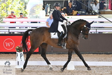 Sarah Farraway from NSW rode her, 'Arawn' by Anamour to take  second place in the Grand Prix Freestyle CDN with 69.100%..